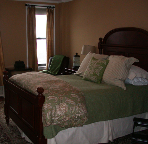This agent-shot bedroom appears small due to the focus on the large bed