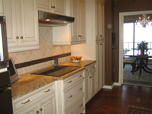 Here is another actual photo taken by an agent.  Again, a very nice kitchen, far from being the smallest space we've seen.  However, with the way this is shot, you get no feel for the size of the actual room...you're only seeing the cabinets and backsplash.  Though those are nice, it would be even better to show them off while also showcasing the actual room itself.