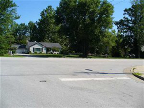 Um...I don't think the house will bite...why not get just a tad bit closer-- so we can actually see more house than pavement!  This home is listed for $350,000 in Indiana