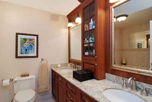VHT's professional photographers contacted the listing agent for the above property and re-photographed the listing.  As you can see, the wide angle lens helps a great deal in opening up the space.  If you look in the mirror you'll see that they've also captured part of the shower in the shot, giving the feeling of a little more space.