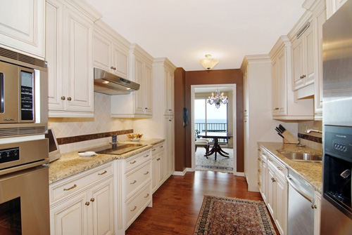 Here again, VHT photographers contacted the listing agent and re-photographed the property.  By capturing more walls and using a wide angle lens, they're able to showcase the entire room-- beautiful cabinets, backsplash, and floors included!  They again also captured the ceiling, giving the room some height and really opening things up a bit.