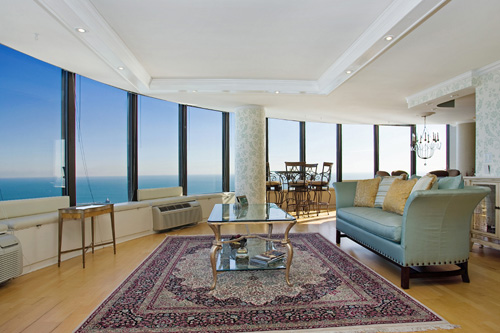 This gorgeous luxury condo on Lake Shore Drive features large windows and beautiful lake views.  It is listed for $975,000 by Mont Wickham of Conlon in Chicago, IL.