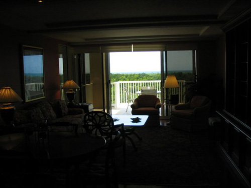 This agent-shot photo is very dark-- you're unable to really see the room at all, just the balcony opening and a shadow of the chair in front of it.  As you can see, they seemed to be shooting directly at the window.