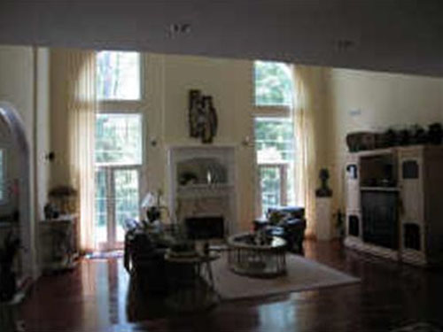 It's such a shame to not showcase a beautiful room like this with such great windows in a way that will attract buyers.  This one really misses the mark...not only has it been shot too far away and directly at the large windows, making them appear very bright and the rest of the room appear a little darker, but it is also very blurry-- not a good way to attract a lot of luxury buyers.  This is a $1,999,999 listing in Georgia.