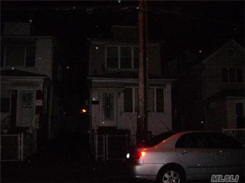 Is there a house somewhere in this picture?  That is one dark street!  This home is listed for $389,000 in Long Island, New York.