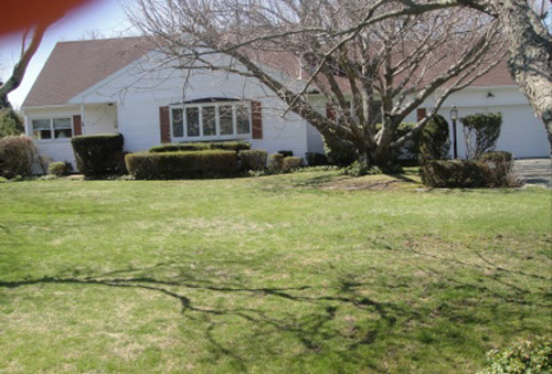 Oh my... a crooked photo complete with a thumb in the upper left corner... probably not the best way to market this $999,000 Long Island listing!