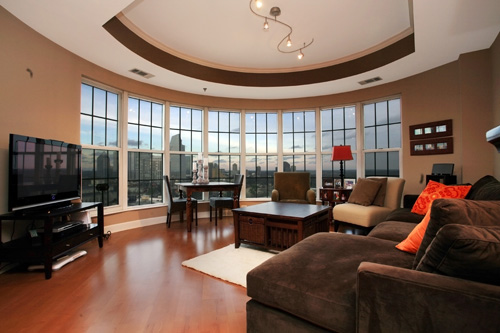 The view of Atlanta is wonderfully displayed in this lovely living room.  This home is listed for $325,000 by Carrie Faletti of Harry Norman.  Click the photograph to view more of this listing.