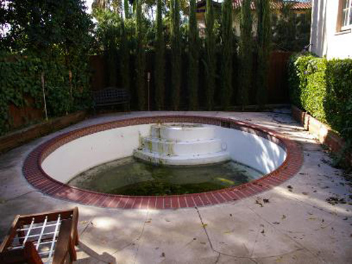 LOL!  Ok, I get that hot tubs are a selling point... but seriously, a close-up of that nasty green water is looking far removed from a relaxing spa...more like a huge, gross headache!  This is a $950,000 listing in California