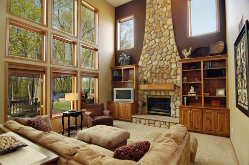 This living room showcases both floor to ceiling windows and a beautiful stone fireplace.  This Minnesota home is listed for $475,000 by Tony Trout of Edina Realty.  Please click the photograph to view more of this listing.